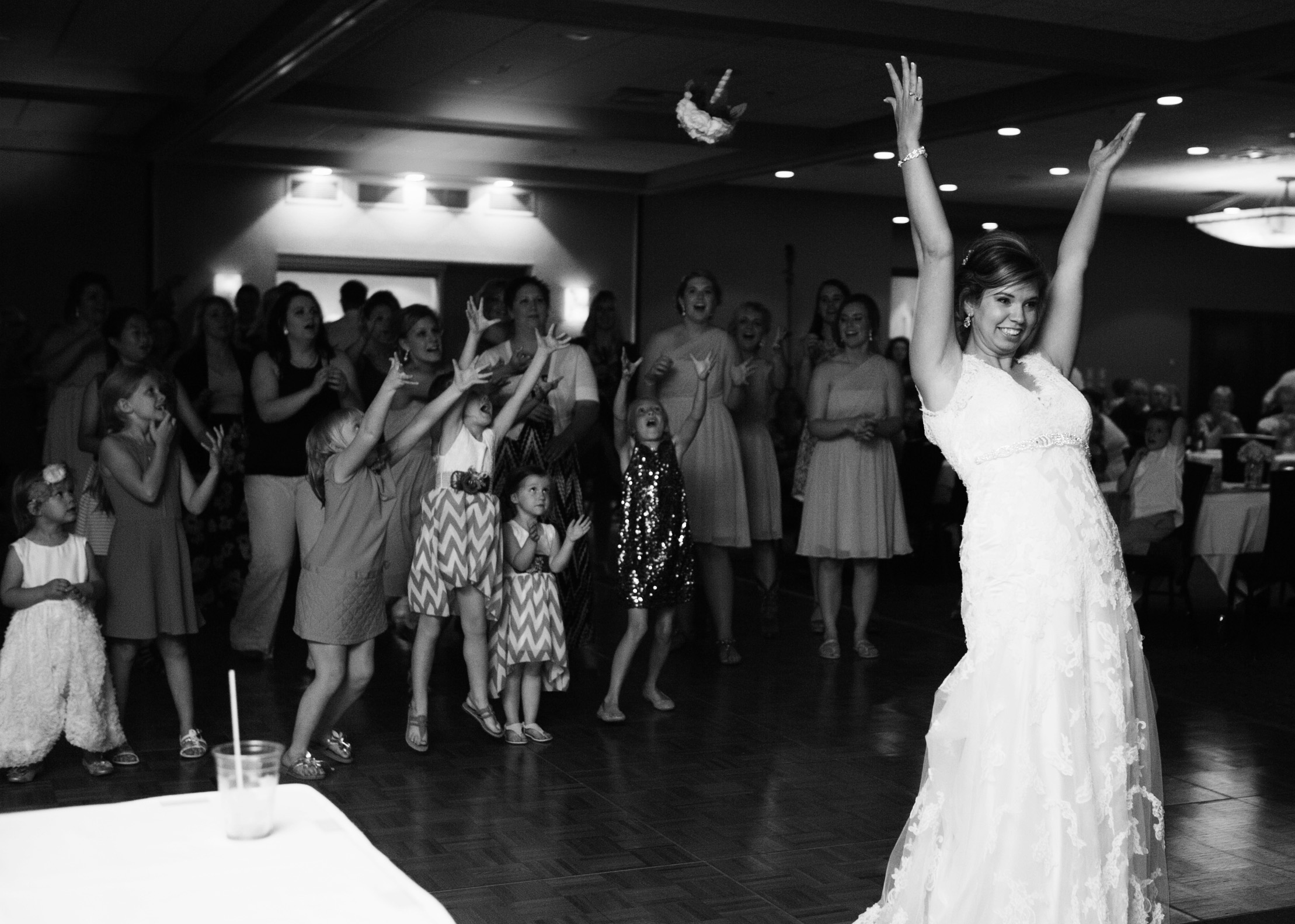 Tossing the bouquet at a Wedgwood Cove wedding in Albert Lea
