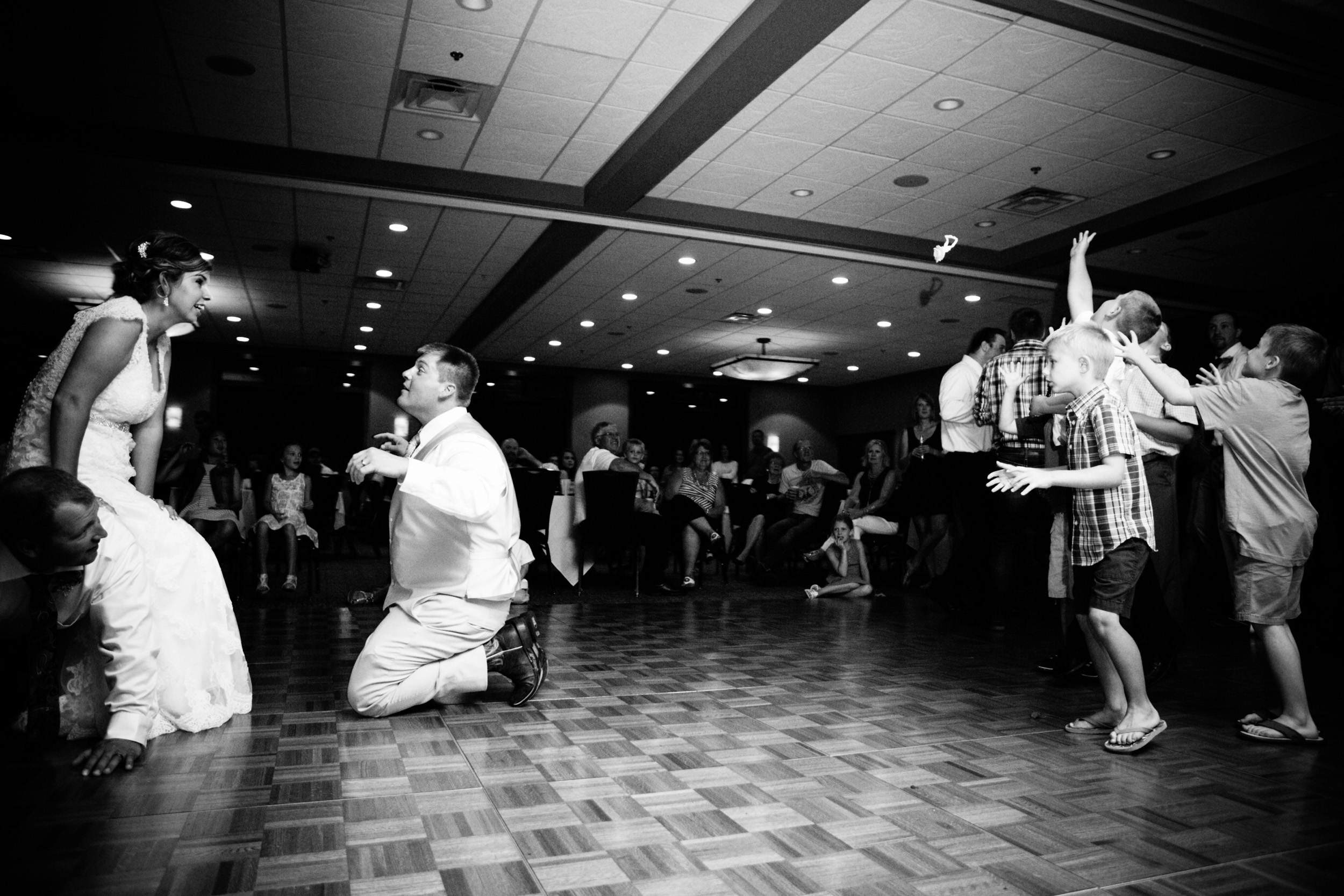 Tossing the garter at a Wedgwood Cove wedding in Albert Lea