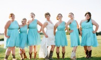 Cowboy boots and bridesmaids at a WedgeWood Cove wedding in Albert Lea, MN