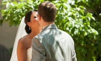 A kiss between the bride and groom at the Crowne Plaza Hotel in Minneapolis