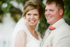 Bride in Maggie Sottero gown, and groom at WedgeWood Cove, Albert Lea